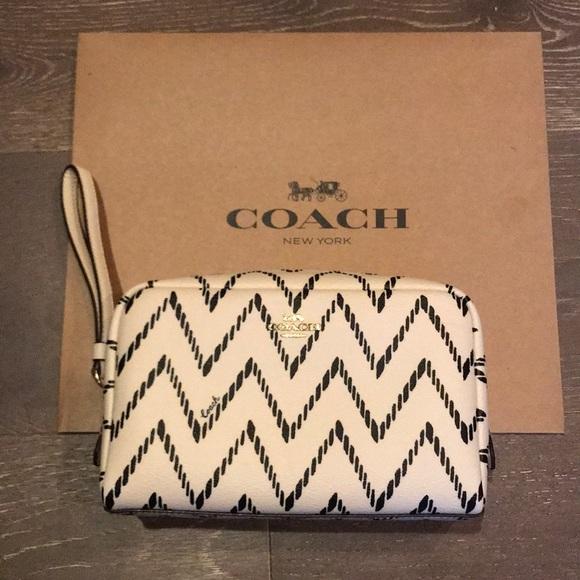 Coach Handbags - COACH Cosmetic Bag. Black/Cream w/ gold detail.